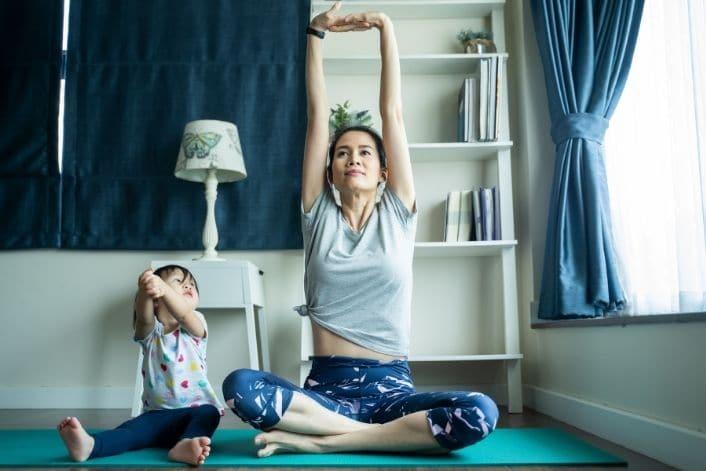 woman doing yoga before mini ivf treatment in sandiego